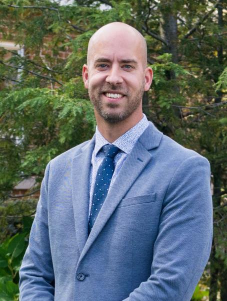 Dr. William den Hollander